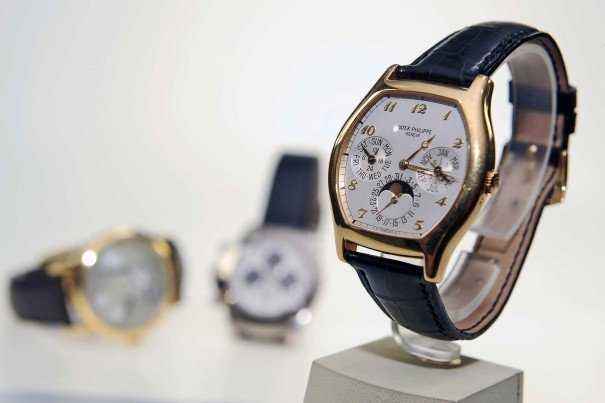 Patek Philippe Watch with golden bezels and leather strap