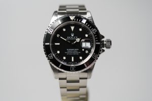 Silver Rolex Submariner Watch with black bezels