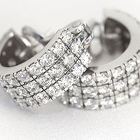 Cut three row diamond hoop earrings